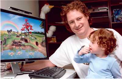 Two-year-old Olive plays The Meadow, a software game for babies designed by her dad, Ken Kavanagh, under his company Clicktoy Interactive Inc.